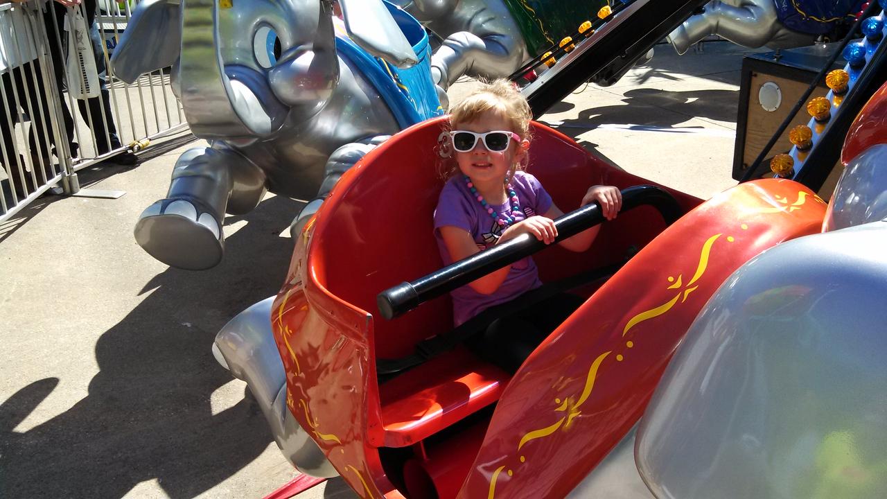 Laney rides the flying elephant ride