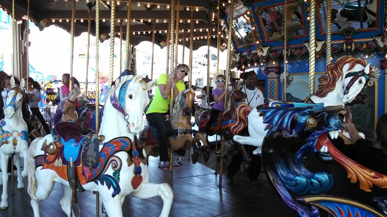 Momma and Laney having a blast on the carousel.