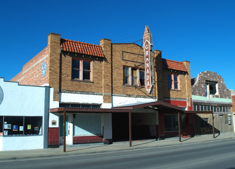 """THE GRANADA THEATER<br /> Alpine, Texas<br /> <br /> Construction started on the Granada Theatre in 1928 and was completed in 1929. The theater was utilized over the years for screening movies as well as being a place for community events, and is shown in the 1945 """"Film Daily Yearbook"""" as open with seating for 1,000. At the time I took this, the Granada was under renovation, and is now a Yoga studio."""