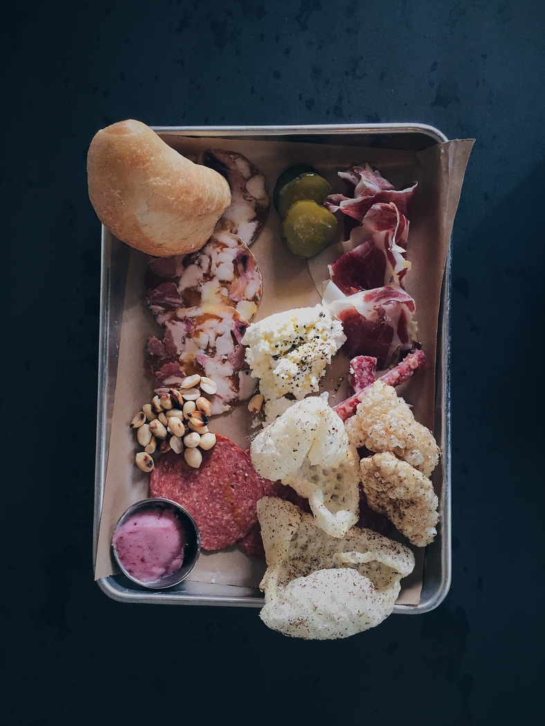Revival Market, one of the best restaurants in Houston, was once a grocery market and now serves killer charcuterie plates.