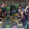 Our group shot - Thai cooking course - with us all adorning aprons of the one size fits all variety.