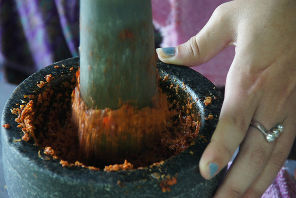 Making Thai curry paste with a pestle and mortar - Chiang Mai, Thailand.