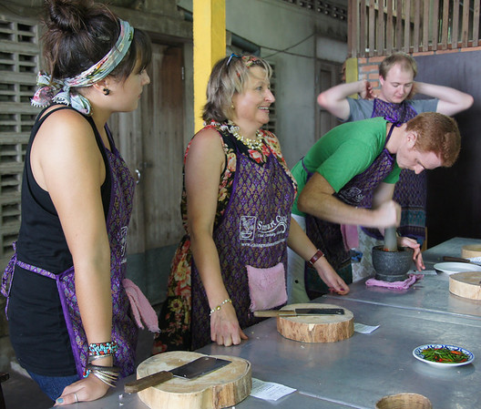 A group of us making curry paste - Thai cooking course.