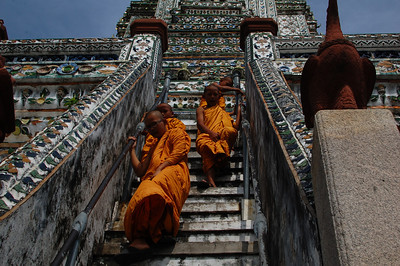 Child monks descending the steps with ease.