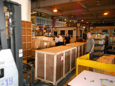 A relieved James and Fabian inspect our crates in Bangkok airport's cargo warehouse.