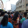 The crowd of people waiting for the chariot to pass.  All the women and little girls are dressed in beautiful saris!