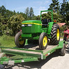 New toy!  Actually, a new scraper tractor.  It is impossible to just go out and purchase a two-wheel drive smallish tractor anymore - this had to be delivered from the factory.  Took about three weeks.