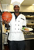 ALL STAR KNICK CHARLES OAKLEY CAN'T DECIDE WHAT HE SERVES UP BETTER -  BASKETBALL OR FOOD AS HE PREPARES A GOURMET MEAL TO BENEFIT THE ATLAS FOUNDATION AT SAMALITA'S RESTAURANT ON THE UPPER EAST SIDE ON 12-2-08.photo by Rob Rich © 2008 robwayne1@aol.com 516-676-3939