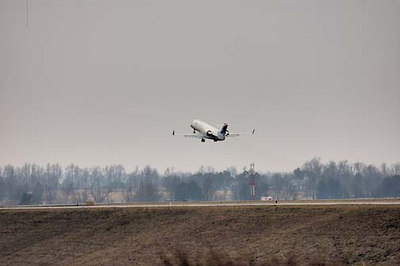 Stock image of a jet airplane taking off from Blue Grass Airport in Lexington Kentucky USA