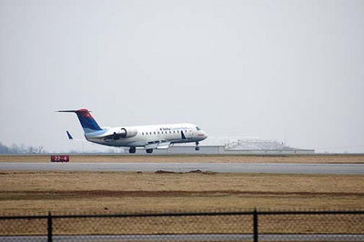 Stock image of a jet airplane landing at Blue Grass Airport in Lexington Kentucky USA