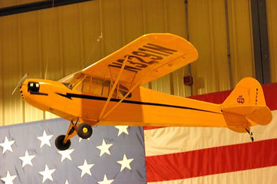 Stock image of small radio-controlled model of a Piper J-3 Cub, a popular general aviation aircraft first built in the 1930s.  Displayed in The Aviation Museum of Kentucky at the Blue Grass Airport in Lexington Kentucky USA