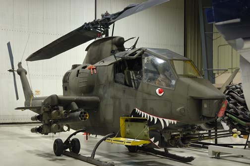 Stock image of  AH-1 Cobra attack helicopter from the Vietnam war.  The sharks mouth was painted on the front of the aircraft to psychlogically intimidate the enemy.  Displayed in The Aviation Museum of Kentucky at the Blue Grass Airport in Lexington Kentucky USA