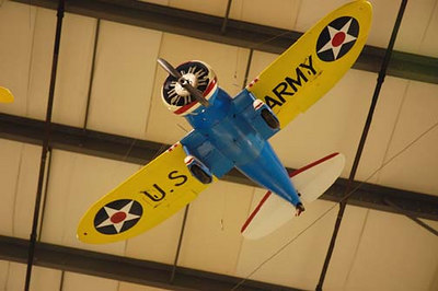 "Stock image of small radio-controlled model of a Boeing P-26 ""Peashooter"", a USAAC fighter plane of the 1930s. Displayed in The Aviation Museum of Kentucky at the Blue Grass Airport in Lexington Kentucky USA"