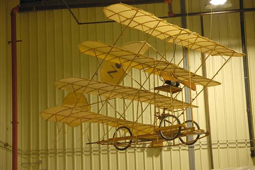 Stock image of a replica of the Sellers Quadruplane, a four wing airplane that was designed, built and flown in 1908 in Kentucky.  It was the first aircraft with retractable wheels.  Displayed in The Aviation Museum of Kentucky at the Blue Grass Airport in Lexington Kentucky USA