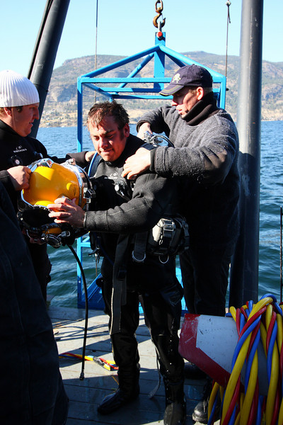 Gear was already partially disassembled by the divers while they were doing their staged, in-water decompression, to help this step go faster