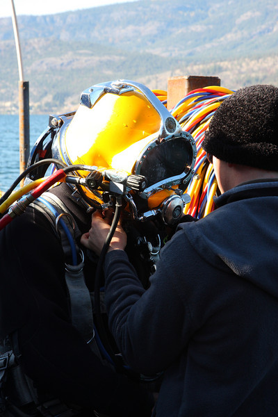 "Diver getting ""hatted"" - As it turns out, commercial divers consider a 30lb lump of brass to be a ""Hat"""