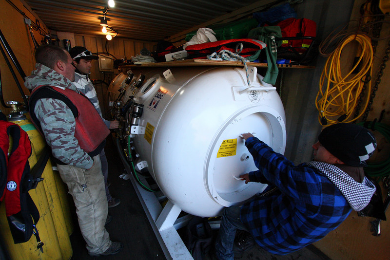With the divers on their way down, chamber operators begin managing the oxygen system that will deliver pure oxygen to the divers as breathing gas, to aid in the decompression process