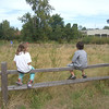 Evrett and his little friend, Stormie, just sitting on the fence