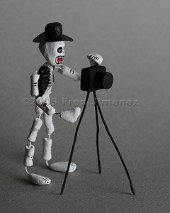 Day of the Dead Photographer. Used an off camera strobe.