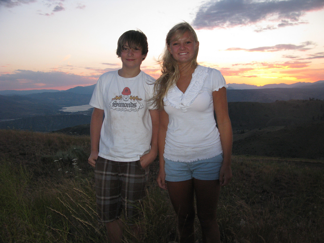 Neat one of the kids on the eastern rim of the columbia river gorge. Sunset and Lake Chelan in far background.