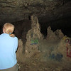 Sue checks out an area in the first cave.