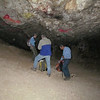 Sue, Roger, and Chuck explore in the first cave.