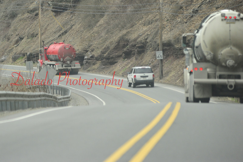 Trucks above Waterville heading to a natural gas operation.