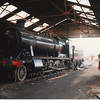 Withdrawn at Cardiff in Jan 64 ex GWR 2-8-0 38322 is under restoration at Wansford on 23/09/89 - future wife admiring the scene!