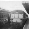 Sheringham sees the passing on a southbound service (left) with my 14 12 Norwich to Melton Constable train on 25/03/64 - despite the roller blind showing Holt!