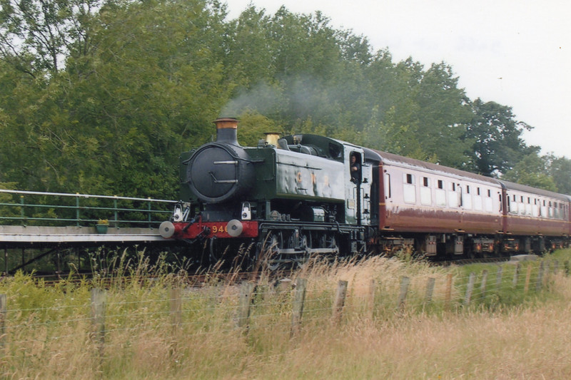Visiting ex GWR 0-6-0PT 9466 arrives into Wymondham Abbey on 06/07/08.