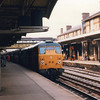 The 12 50 Peterborough to Harwich Parkeston Quay calls at Ipswich on 01/10/84 with Stratford (no heat) 31125.