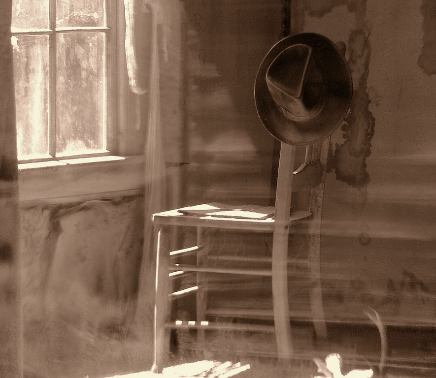 "Peering through the windows, you get a sense that the residents of Bodie have just stepped out and will return at any moment. There are many scenes like this; I call it ""Waiting For Its Owner"".  I used the in-camera Sepia color effect to enhance the nostalgic mood of the setting."