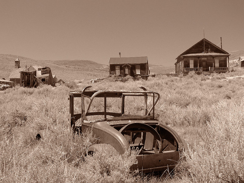 I spied this old abandoned car in the sagebrush and placed it squarely in the foreground of the distant houses. An eloquent symbol for the town abandoned by its residents...