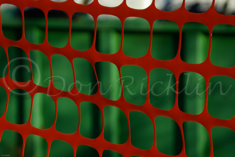 Red plastic snow fence, Green recycle cantainer.<br /> Department of Poblic Works, Phillipston, MA