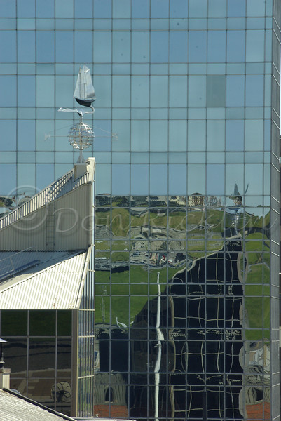 Wind Vane<br /> <br /> Reflection of Halifax Fort in Glass Tall Building.