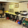 Today's goal (10-25-09) was to clean up the right-hand wall of the garage and make a temporary workbench.  Mission accomplished.  This will make it easier to do on-going maintenance on the bikes and the car, and to sort through that pile of boxes one at a time.