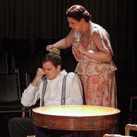 Mark Maynard | for The Herald Bulletin<br /> Young Tom Wingfield (Joshua Wilkinson) cringes as his mother Amanda (Angela Gick) brushes his hair.