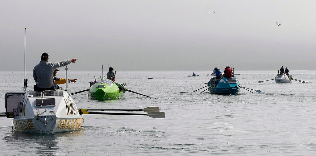 . Entrants row their boats on June 9, 2014 in Monterey for the start of the Great Pacific Race 2014. Thirteen teams from around the world battle it out on a grueling 2,400 mile stretch of the Pacific Ocean from Monterey to Honolulu.  (Vern Fisher - Monterey Herald)