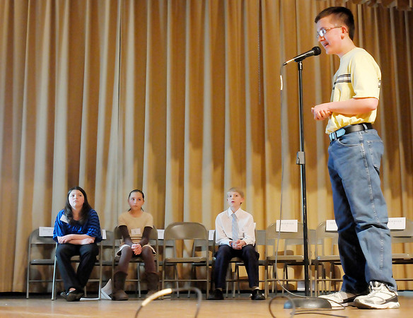Joseph Kirkpatrick won his third The Herald Bulletin regional spelling bee at the Anderson City Building auditorium on Wednesday. Seated in the background from left are third place finisher Larissa Partlow, fourth place finisher Shiloh McFarland, and second place finisher Bradley Riser.