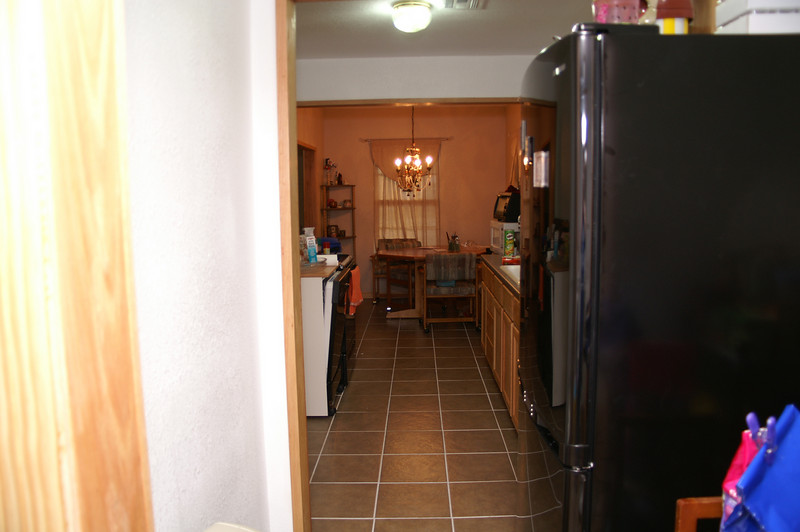 Showing the kitchen and dining room from the utility room.