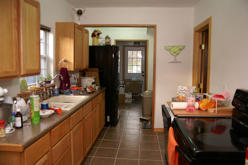Taken from the dining room showing the length of the kitchen and utility room.