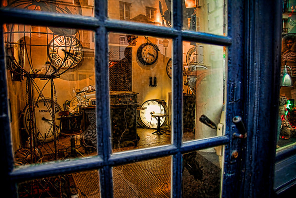 The Clock Shop of Montmarte I'm working on a story for this image, only got the bare bones so far. It has to do with converging folds in time in the final hours of dual universes (who have been in mortal combat with each other since the beginning of time), and the reality-altering decision made by ultimate Keeper of Time - all hinging upon a seemingly simple clock repair shop in Montmartre, Paris, France.   Ya know, the basics.
