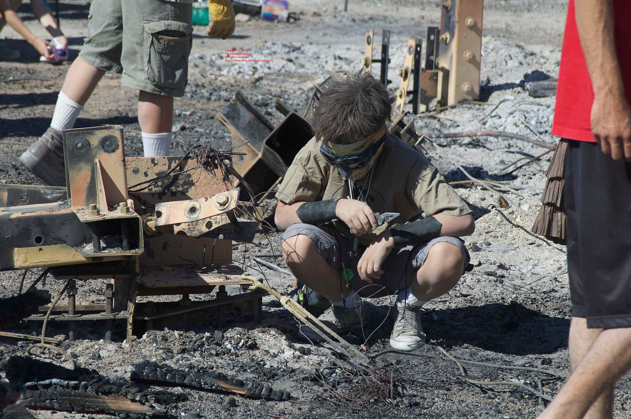 People sift through the ashes and debris looking for items that speak to them, often melted glass or metal, which they can keep as a souvenir or as a basis for art.