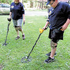 Lauren Rearick/NEWS<br /> Bonnie Mong and her son, Devin, use metal detectors to see what kind of treasures might lie hidden at Cascade Park.