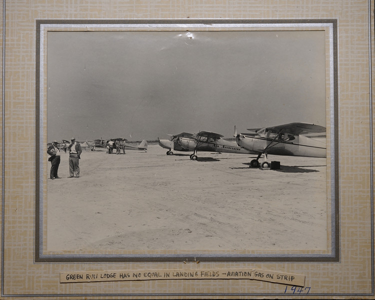 "The first time I saw this photo I was flabbergasted, airplanes landing on the beach where I have fished for the last 20 years!  The planes landed at Foxhill Levels. Is that neat or what! Thanks to Dewey Parsons for sharing the photo!  RIP Dewey.<br /> <br /> Landing on the beach was a bit tricky especially for first timers, often the plane would nose over and bend the propeller.....no problem there was always someone who would fly a new one down in a couple hours. The bent props were hung on a lodge wall for ""discussion""!<br /> <br /> A brochure, believed to be dated 1949-50, describes the [original] lodge as follows: ""accommodations for 28 persons and<br /> facilities have been installed for men and women . . . inside showers and toilets, recreational rooms, with fire-place; billiard<br /> and card tables .. . large Electric Plant for light and power.... Bed lights for night reading with press button in each room for<br /> service to guests .. . modern sanitary sewerage system .. . the superintendent and his wife, guides and porters cater to the<br /> pleasure of guests. The Club also has a chef that knows Maryland cooking and how good food should be served .. . prepares<br /> and packs hot lunches for the Gunners ... . Porter Service is maintained at the Lodge, and not one item of service is missing . .<br /> .. Guides are all experienced . . . have followed the hunting business all their lives . . . All guides and employees are housed<br /> and roomed separately, hence their early morning preparations to go to the blinds do not disturb the guests until breakfast call<br /> is made ... . The Lodge has over 500 wooden Geese and Duck decoys; several motor boats, out-board motor boats, and<br /> several skiffs to haul decoys to the blinds. The Lodge also has one light draft motor boat, which has a covered cabin with a<br /> very light draught [sic], built just for going to and from the shore and Island blinds. . .Green Run Lodge has some 32 shooting<br /> blinds ... . We have Chesapeake Bay Retrievers at our Lodge. Guests are permitted to bring free of charge their Retrievers to<br /> our Lodge ... . Thousands of Black Ducks are hatched and reared in the Lakes at present, in fact more Black Ducks are reared<br /> at Green Run Lodge, than are legally killed there in Season .. . rates are $30.00 per day per guest for Duck and Goose<br /> shooting. This price includes Guides, motor boats to and from the blinds, room and board, including hot lunches and all<br /> conveniences thereto attached, also meeting you and party on mainland by motor boat or car, at a place we will designate ... .<br /> Our Airport is approximately 5,000 feet long and 2,500 feet wide ... . There have been seventy-nine airplanes on our Strip at"