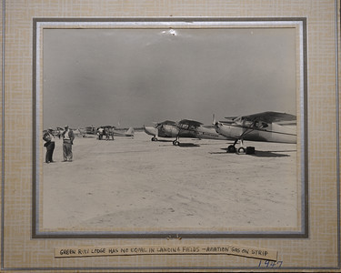 """The first time I saw this photo I was flabbergasted, airplanes landing on the beach where I have fished for the last 20 years!  The planes landed at Foxhill Levels. Is that neat or what! Thanks to Dewey Parsons for sharing the photo!  RIP Dewey.  Landing on the beach was a bit tricky especially for first timers, often the plane would nose over and bend the propeller.....no problem there was always someone who would fly a new one down in a couple hours. The bent props were hung on a lodge wall for """"discussion""""!  A brochure, believed to be dated 1949-50, describes the [original] lodge as follows: """"accommodations for 28 persons and facilities have been installed for men and women . . . inside showers and toilets, recreational rooms, with fire-place; billiard and card tables .. . large Electric Plant for light and power.... Bed lights for night reading with press button in each room for service to guests .. . modern sanitary sewerage system .. . the superintendent and his wife, guides and porters cater to the pleasure of guests. The Club also has a chef that knows Maryland cooking and how good food should be served .. . prepares and packs hot lunches for the Gunners ... . Porter Service is maintained at the Lodge, and not one item of service is missing . . .. Guides are all experienced . . . have followed the hunting business all their lives . . . All guides and employees are housed and roomed separately, hence their early morning preparations to go to the blinds do not disturb the guests until breakfast call is made ... . The Lodge has over 500 wooden Geese and Duck decoys; several motor boats, out-board motor boats, and several skiffs to haul decoys to the blinds. The Lodge also has one light draft motor boat, which has a covered cabin with a very light draught [sic], built just for going to and from the shore and Island blinds. . .Green Run Lodge has some 32 shooting blinds ... . We have Chesapeake Bay Retrievers at our Lodge. Guests are permitted to bring free of ch"""