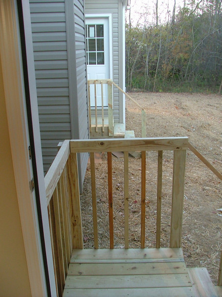 """""""Baby Decks"""" off the two back doors...Plans in the works for a big deck and patio into the woods...."""
