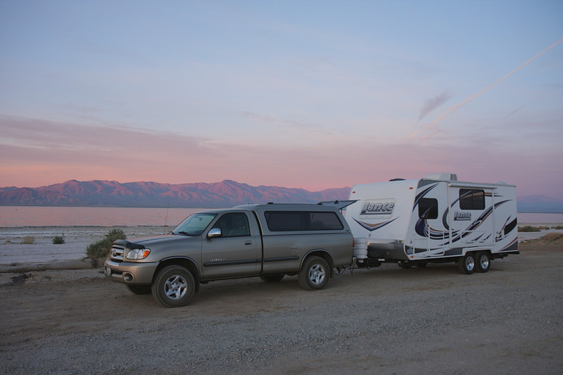 My most recent trip to the Salton Sea was February 1 - 6 2012. It was my first time there with the travel trailer I'd bought in late November 2010, the Lance 1685. I stayed at Headquarters Campground, which had fully-equipped RV sites and a dump, then dry-camped for a day at this place, Corvina Campground right along the beach. This was taken at sunrise, February 6, 2012.