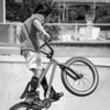 Earnest face as he gets some air. BMX bikes are allowed in the park on Mondays.