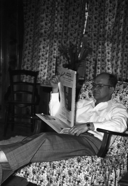Dad sitting in his platform rocker in our Living Room at 213 South Main Street.